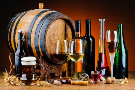 21524425 - still life with different alcoholic drinks and wooden barrel