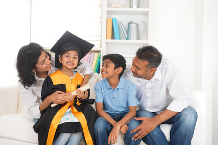 25905708 - happy indian family graduation, education concept photo