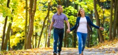 26588935 - urban leisure - woman and man walking in park