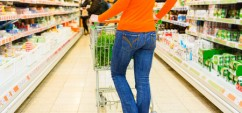29075653 - woman driving shopping cart while grocery shopping in supermarket