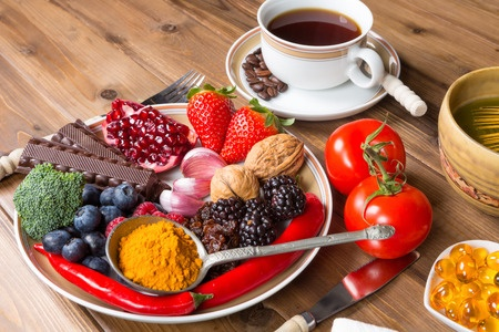 31358649 - wooden table filled with antioxidant drinks and food
