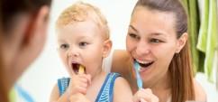 34155143 - cute mother teaching kid boy teeth brushing