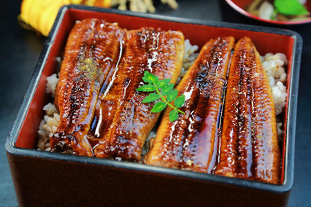 38232659 - japanese food, unajyu, eel and rice in a lacquered box