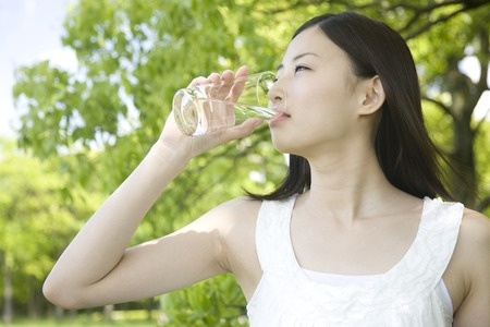 40155517 - woman drinking water
