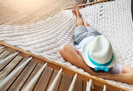 40901691 - lazy time. man in hat in a hammock on a summer day