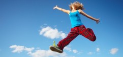 43882861 - young happy woman jumping on blue sky background