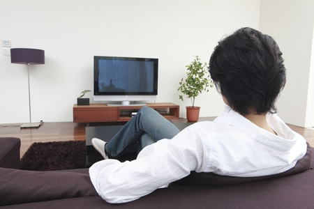47124145 - rear of the men who watch tv in the living room