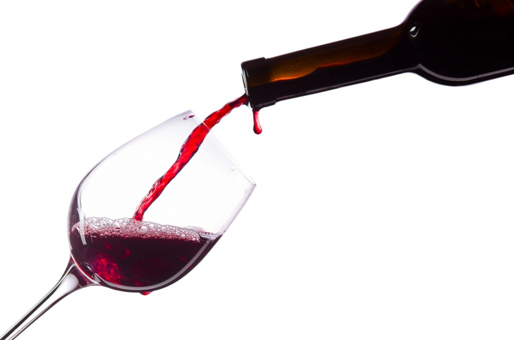 51524780 - red wine in wineglass on white background